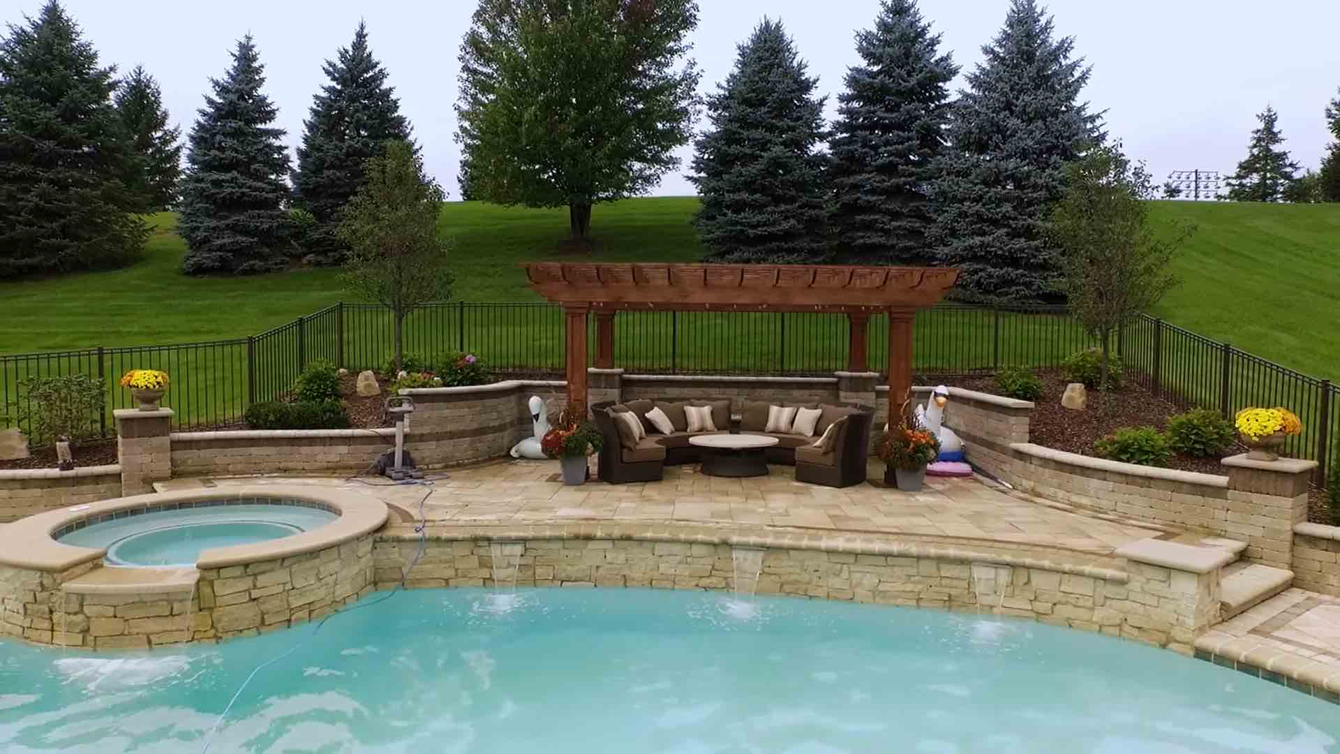 poolside seating and spillover spa connecting into pool