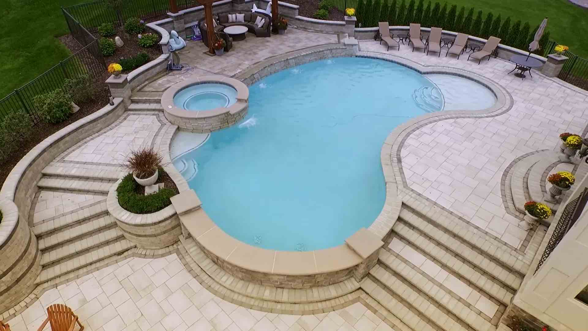 view from above of pool with spillover spa
