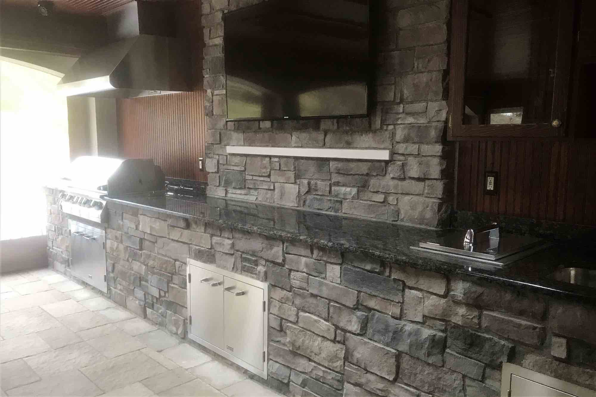 poolside kitchen with bar & TV