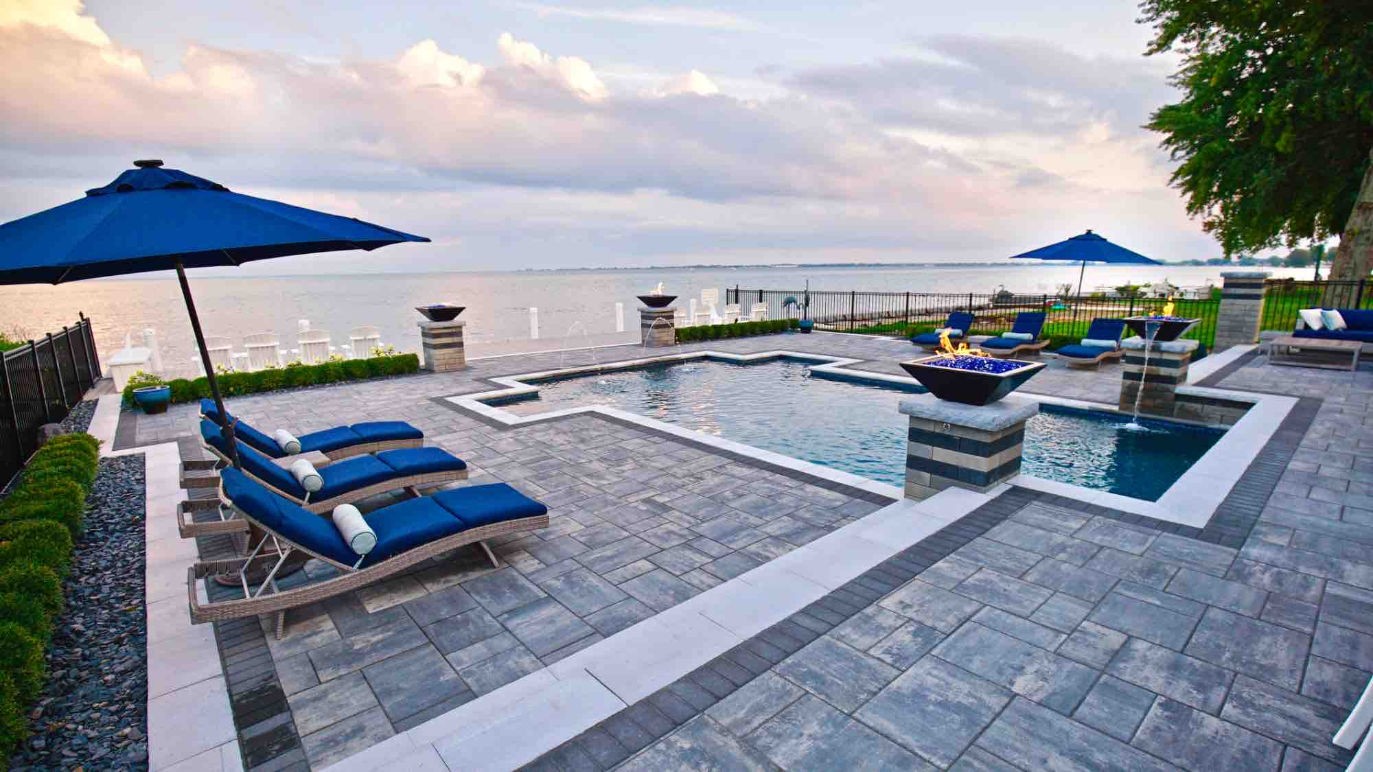lakeside pool with fire pillars & lakefront patio