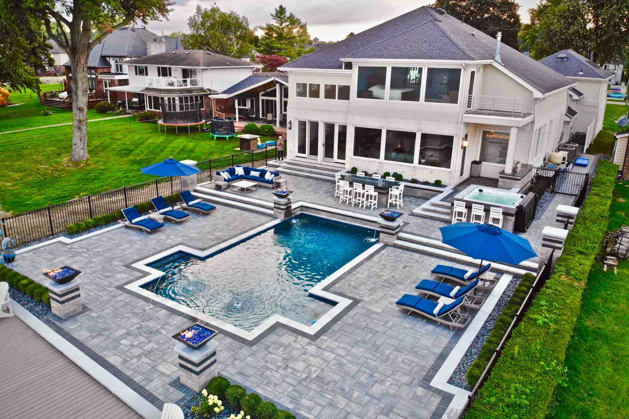 aerial view of lakeside pool and patio