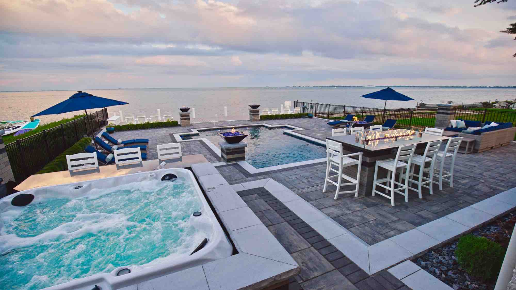 lakeside pool with adjacent hot tub and lakefront patio