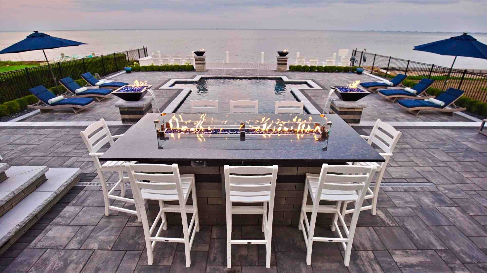 dining table next to lakeside pool