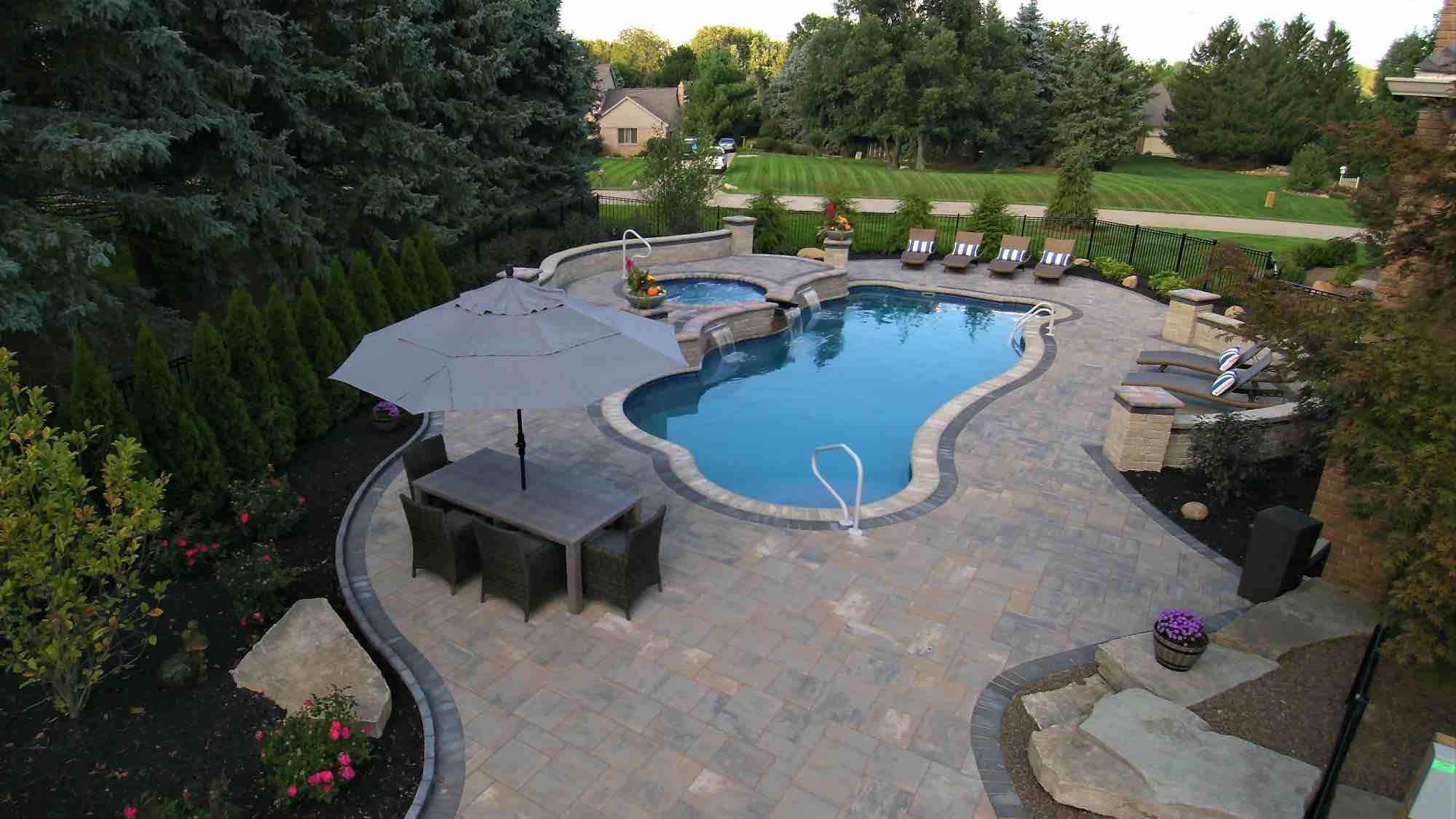 pool with spillover hot tub