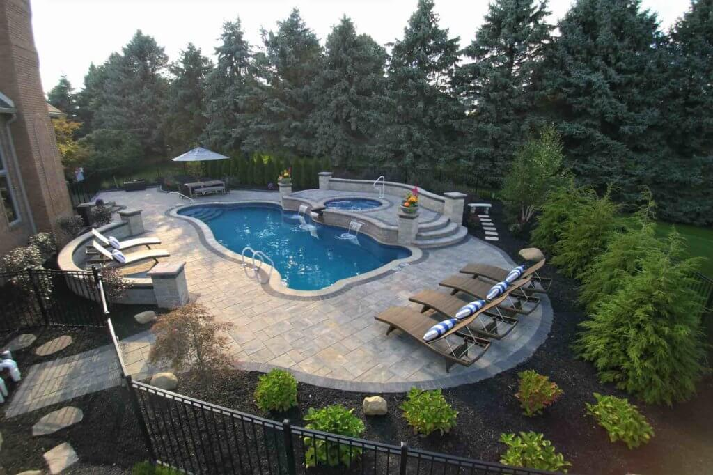 pool with a spillover hot tub