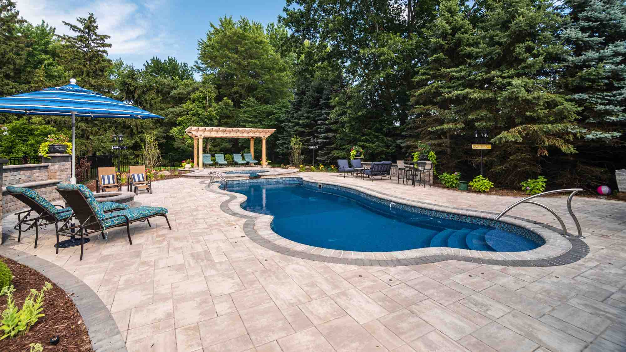 backyard patio and pool with deck tables and chairs