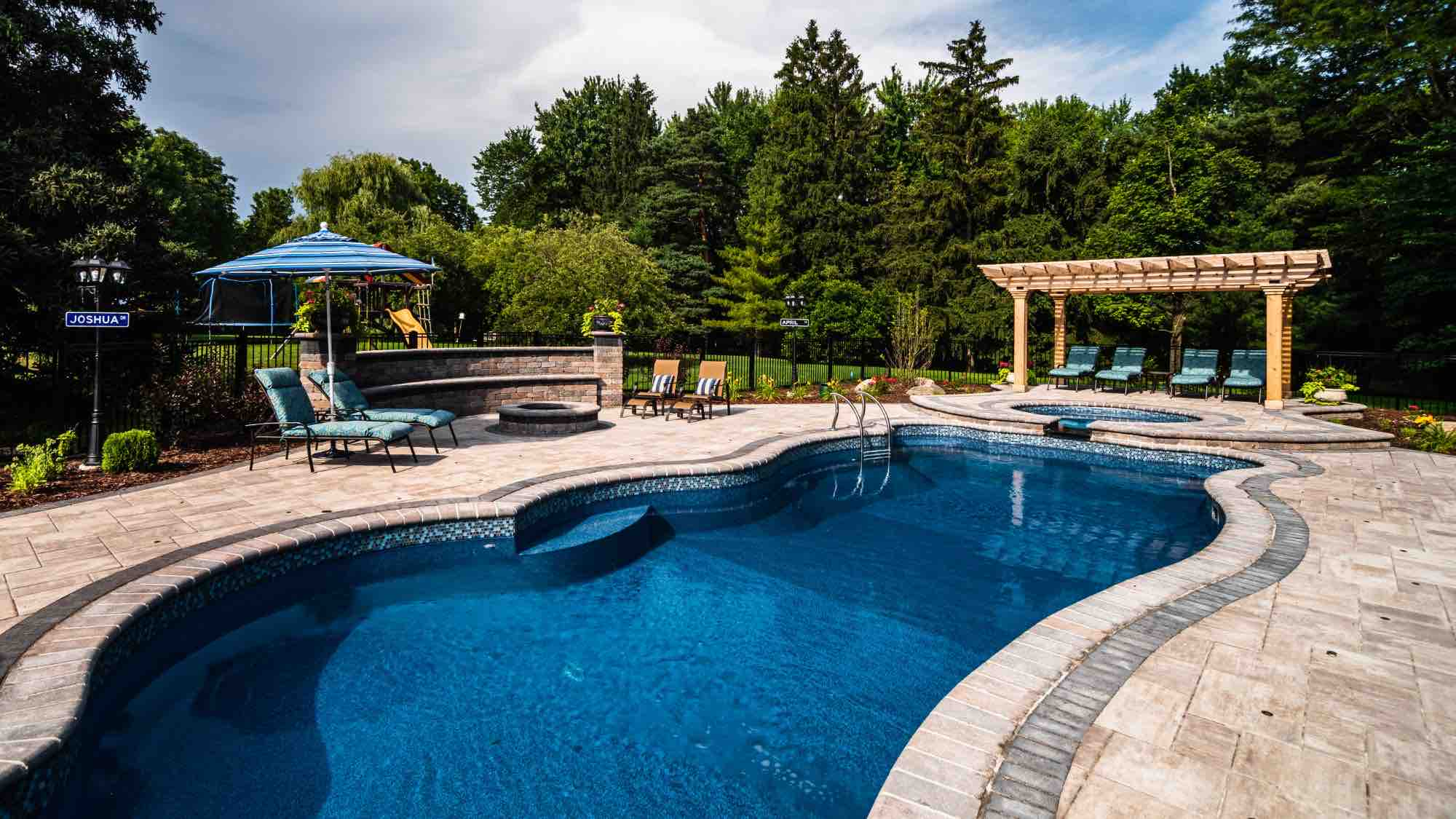 pool and hot tub with poolside firepit