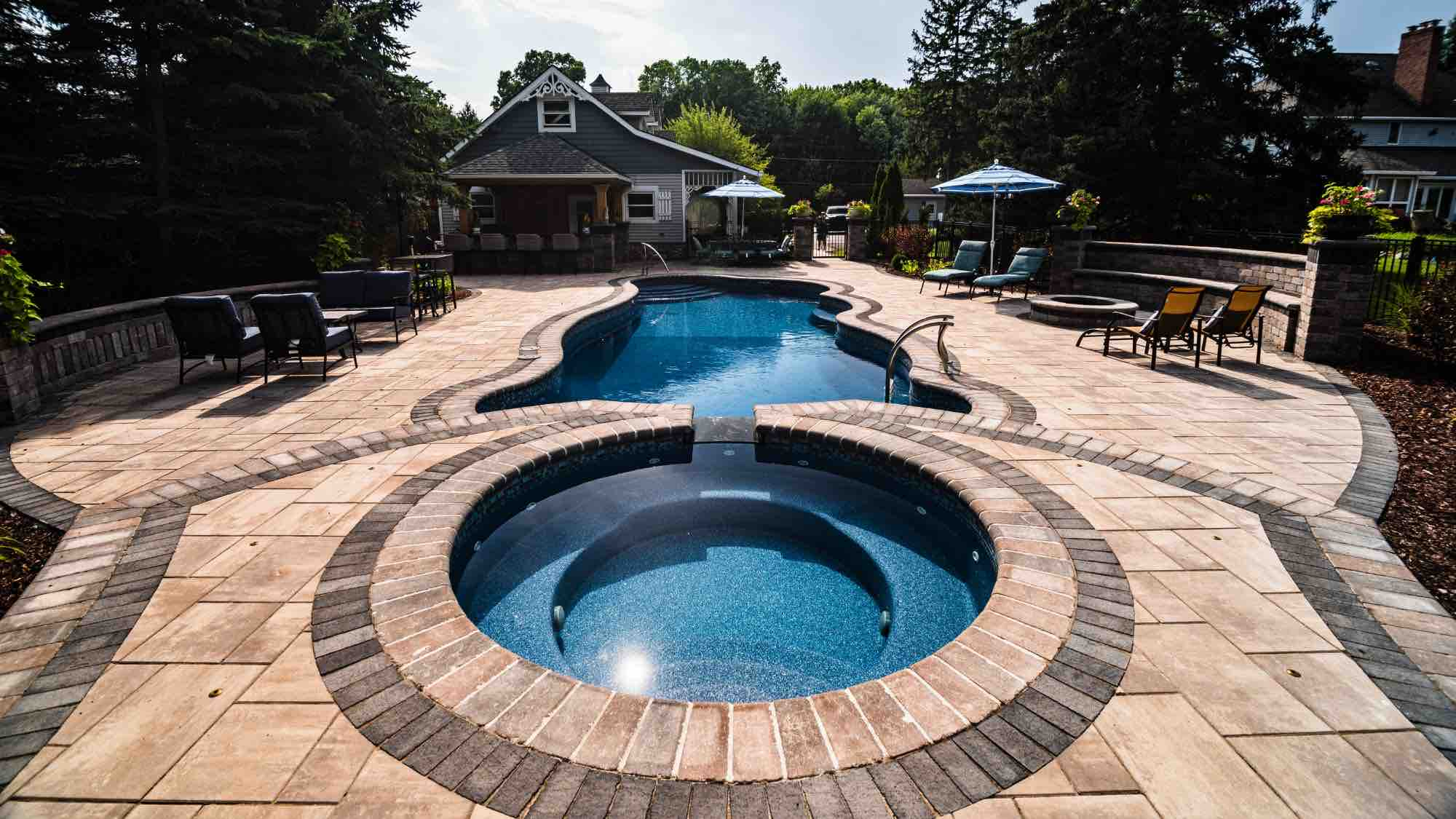 hot tub and pool with patio and firepit