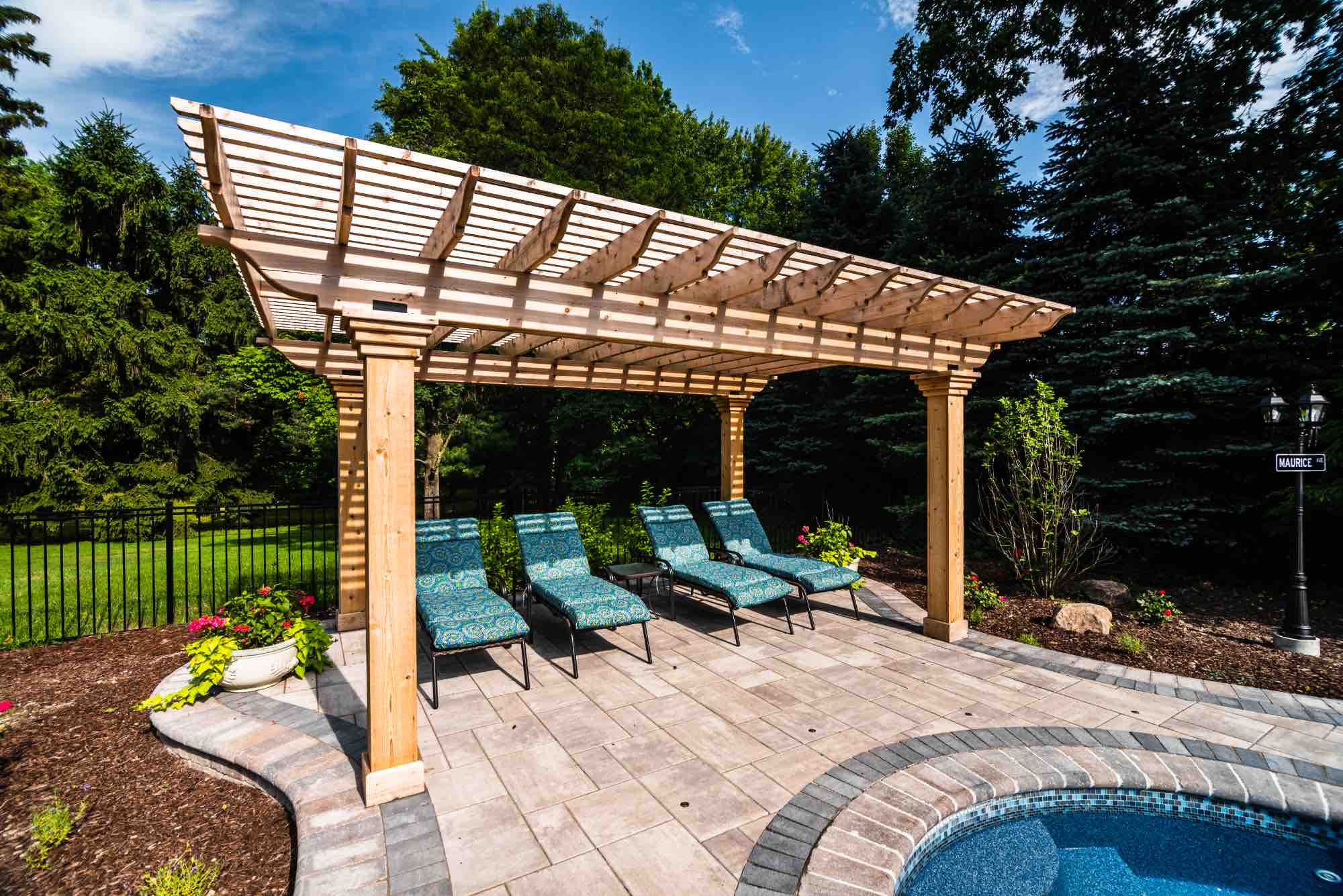 covered seated area next to backyard pool