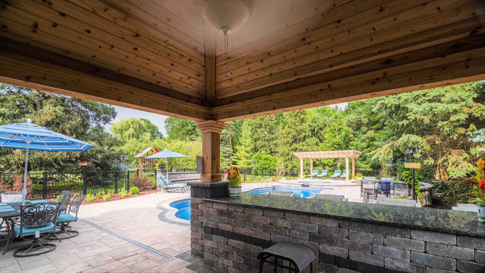 view of pool from outdoor kitchen