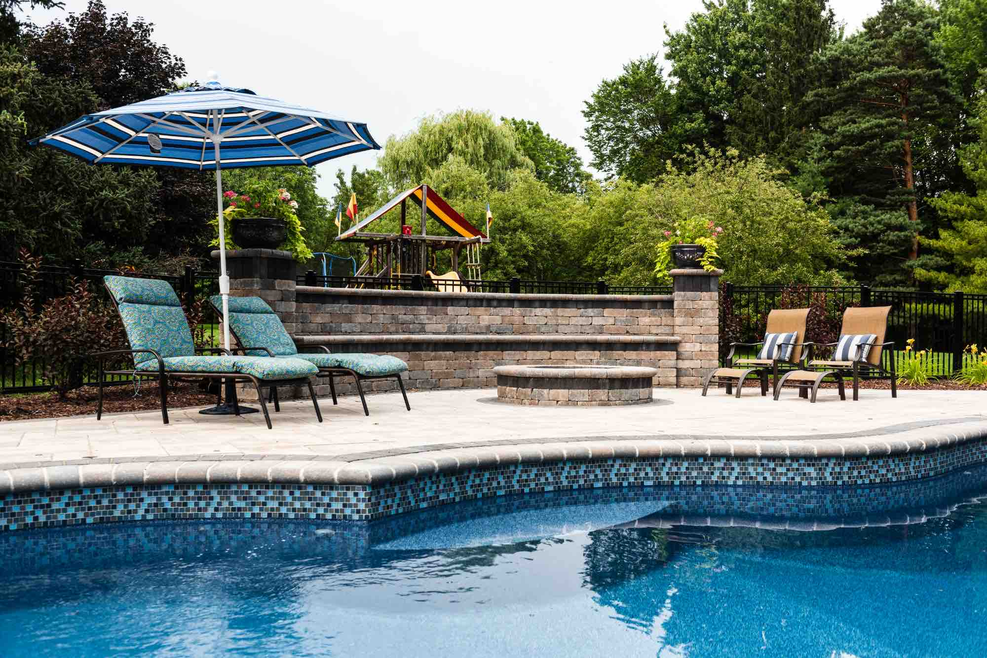 fire pit installed in poolside deck