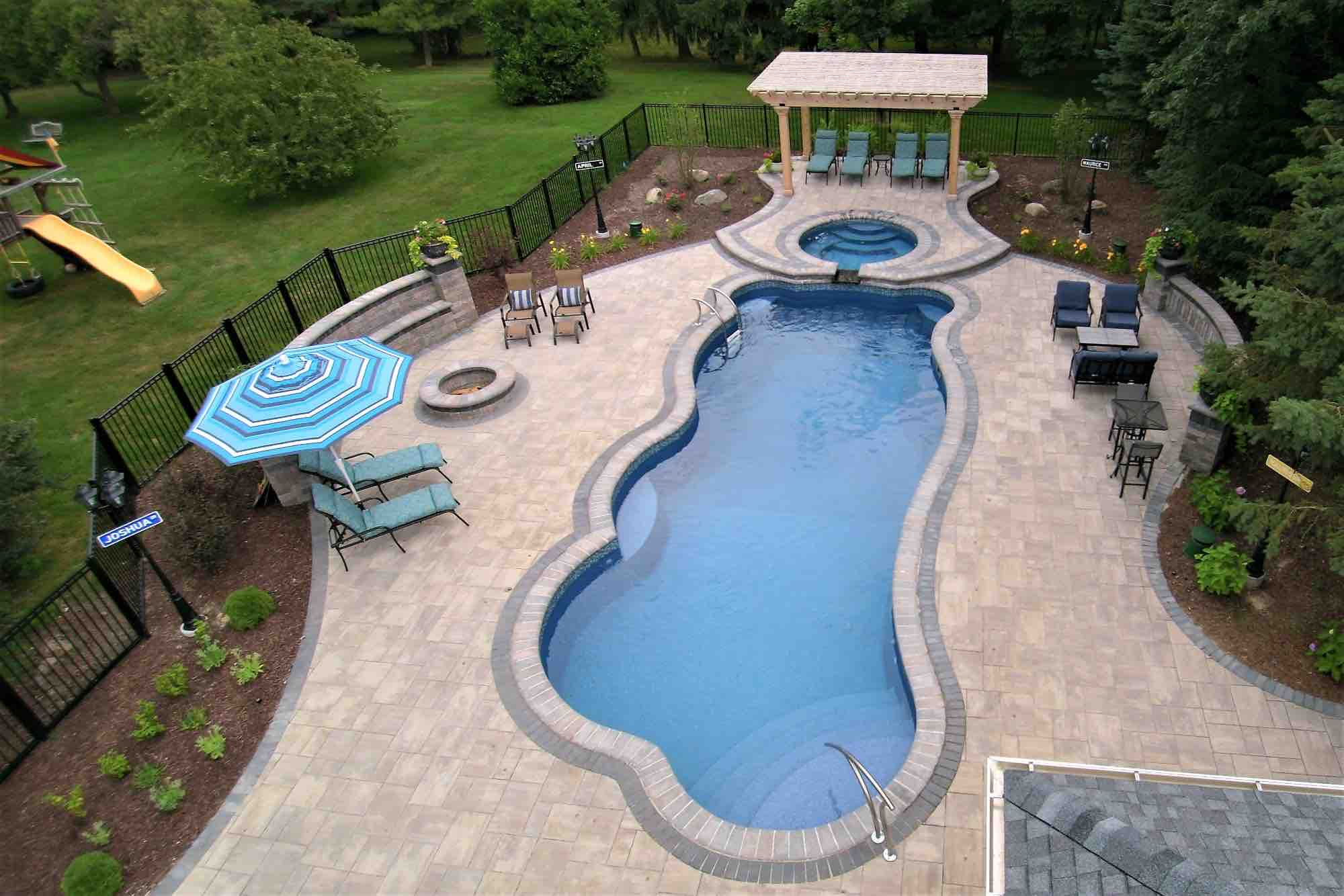aerial view of pool, hot tube, fire pit and poolside lounge