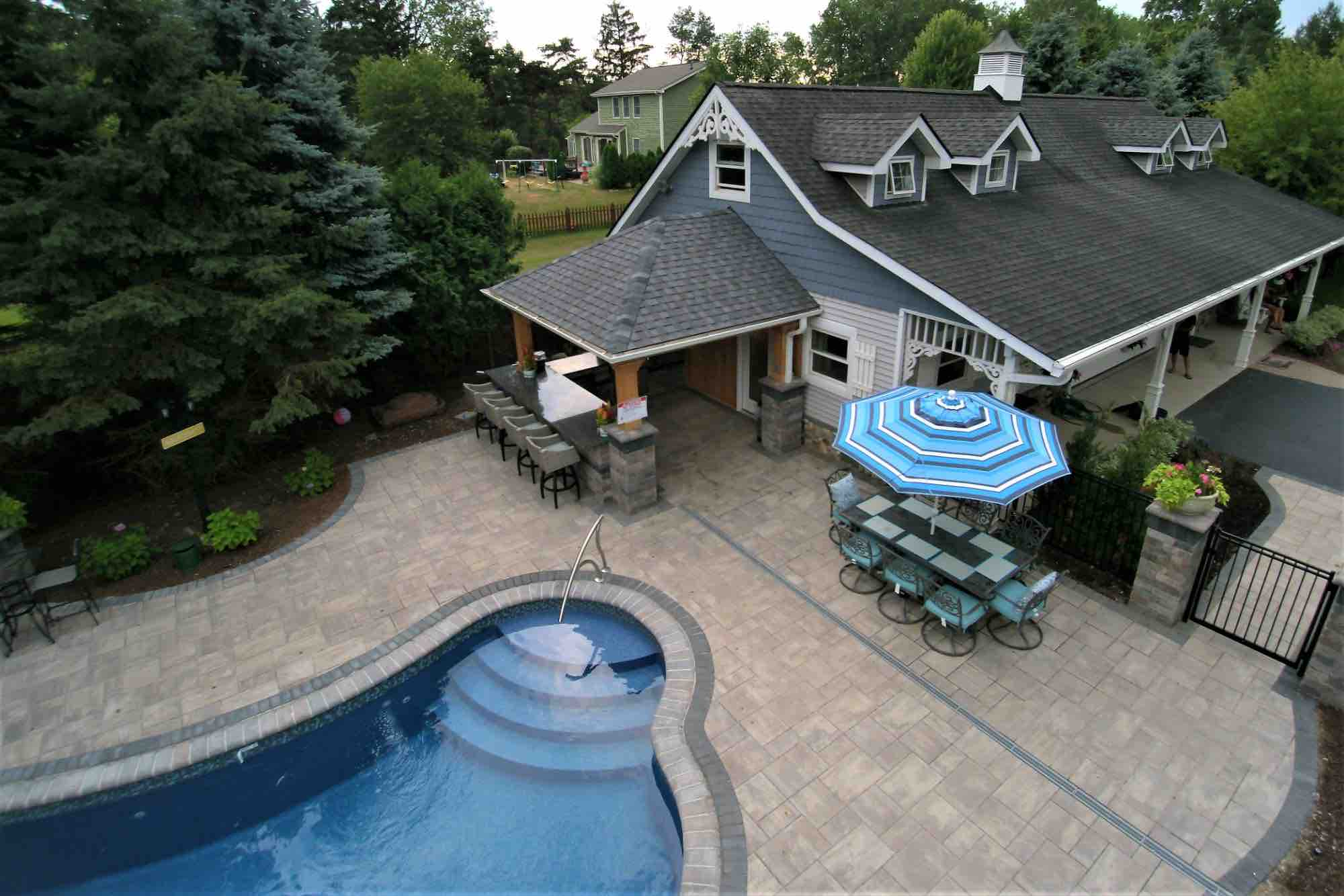 aerial view of poolside outdoor kitchen